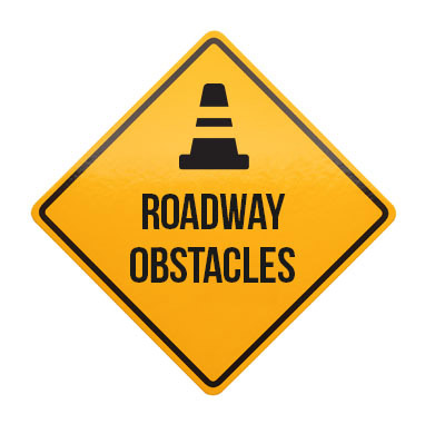 Defensive driving course details include roadway obstacles.