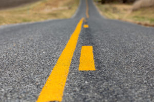 if you're on the side of the road with the broken yellow line on it, it means you are allowed to pass.